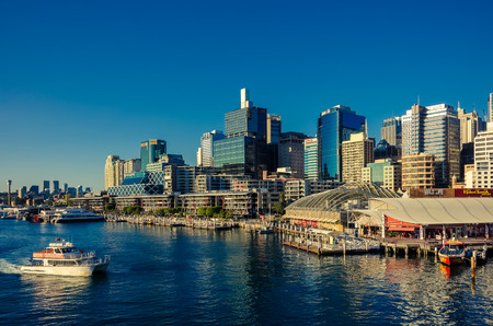 darling: Sydney, Australia - September 14, 2012: Beautiful Darling Harbor skyline with boats at sunset. Darling Harbour is a large recreational and pedestrian precinct that is situated on western outskirts of the Sydney CBD Editorial