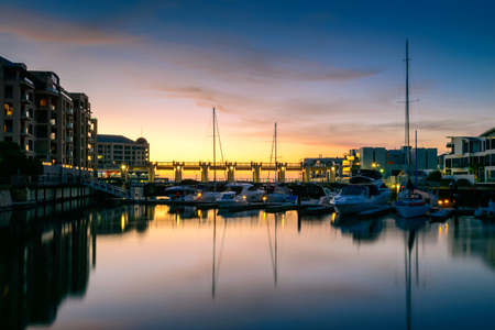 holdfast: Boats parked in the docks of Patawalonga lake at Glenelg on a beautiful evenning at sunset. Long exposure settings applied. Stock Photo