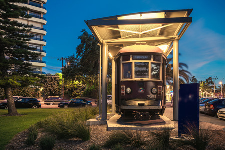 holdfast: Adelaide, Australia - November 8, 2014: Historic red rattler tram in Glenelg on a permanent display at night time. Color-toning and long exposure effect.