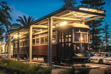 adelaide: Adelaide, Australia - November 8, 2014: Historic red rattler tram in Glenelg on a permanent display at night time