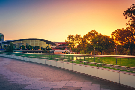 adelaide: Adelaide, Australia - January 18, 2015: Riverbank foot bridge across Torrens River in Adelaide City Business District at sunset, South Australia. Color-toning applied