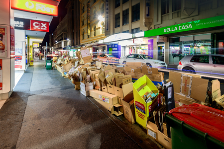 recyclable: Adelaide, South Australia - August 11, 2015: Recyclable waste collection day in Adelaide city. Night view of the street with paper boxes