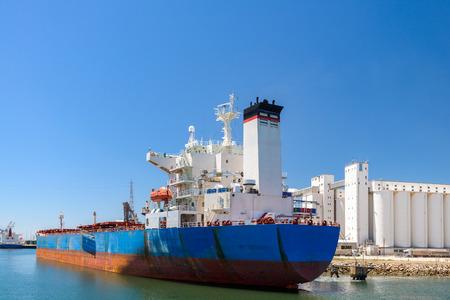 Bulk carrier ship unloading in the port