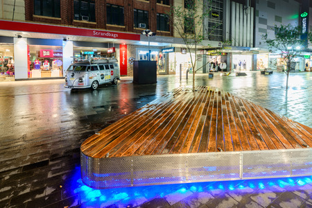 Adelaide, Australia - August 11, 2015: Adelaides famous Rundle Mall at night time under the rain during winter season