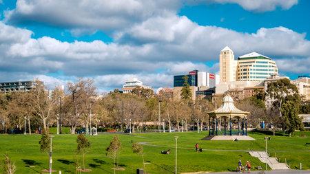 city park skyline: Adelaide, Australia - September 11, 2016: Adelaide city skyline viewed across Elder Park on a bright day