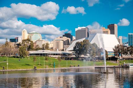 adelaide: Adelaide, Australia - September 11, 2016: Adelaide city skyline viewed across Elder Park on a bright day