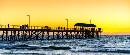Henley Beach Jetty on a warm sunny evening. Stock Photo