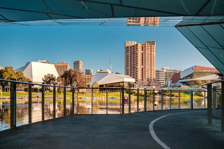 foot bridge: Adelaide, Australia - September 11, 2016: Adelaide city centre viewed from under the foot bridge in Elder Park on a bright day Editorial