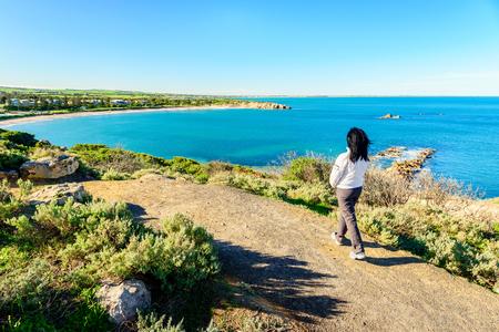 elliot: Woman walking along the heritage trail at Port Elliot, Horseshoe Bay, South Australia,