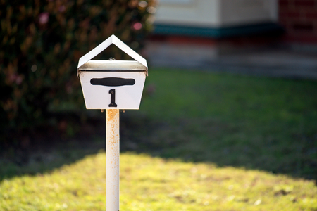 Australian home letterbox with number one on frontyard Stock Photo