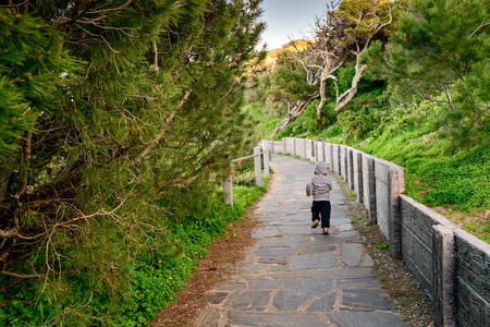 elliot: Little boy running along the pathway at Port Elliot, South Australia