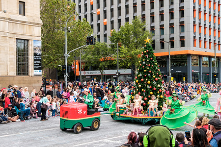 than: Adelaide, South Australia - November 12, 2016: More than 250.000 came to the city centre to see 172 colourful sets of floats, bands, dancers, clowns and Father Christmas. The Credit Union Christmas Pageant is one of the biggest events in South Australia