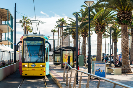 holdfast: Adelaide, Australia - August 16, 2015: Tram at Moseley Square stop ready to depart towards Adelaide city. Moseley Square is a public place in the City of Holdfast Bay at Glenelg.