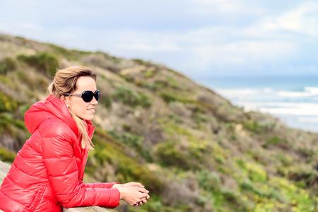 Woman enjoying the sea view at Goolwa beach, South Australia Stock Photo