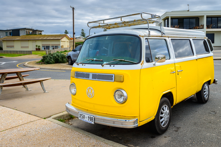middleton: Adelaide, Australia - August 14, 2016: Classic yellow Volkswagen Transporter camper van parked on a street at Middleton beachfront Editorial