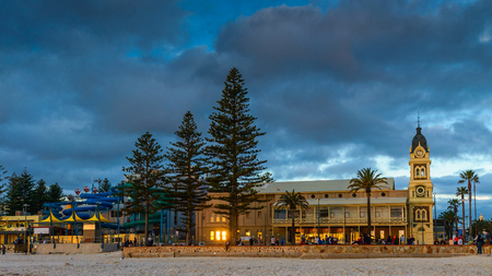 Adelaide, Australia - August 16, 2015: Glenelg Town Hall at sunset with people around near Moseley Square, Jetty Road, South Australia