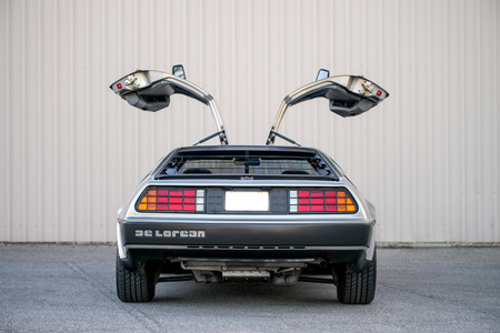 Adelaide, Australia - September 7, 2013: DeLorean DMC-12 car with opened doors parked on street near shed Reklamní fotografie - 70061143