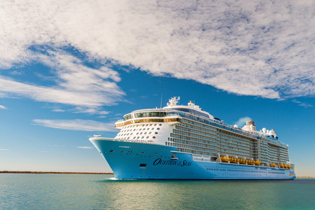 Port Adelaide, South Australia, February 14, 2017:  MS Ovation of the Seas cruise ship leaving Outer Harbour. It is third ship in the Quantum Class of passenger ships