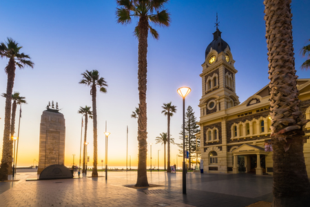 Adelaide, Australia - August 22, 2015: Moseley Square with Pioneer Memorial in the middle at night. Moseley Square is a public square in the City of Holdfast Bay at Glenelg. Long exposure camera settings