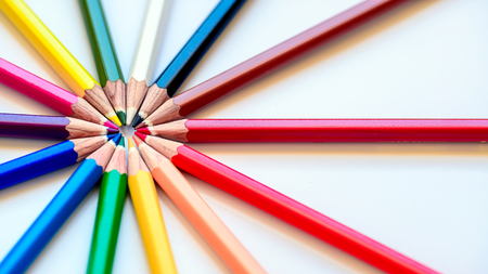 working on school project: Close up macro shot of sharp colorful pencils Stock Photo