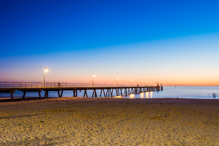 People walking on Glenelg Jetty at sunet, South Australia