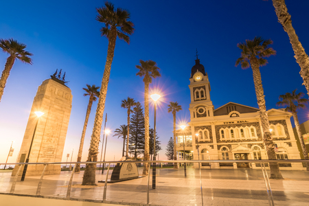 Adelaide, Australia - August 22, 2015: Moseley Square with Pioneer Memorial in the middle at night. Moseley Square is a public square in the City of Holdfast Bay at Glenelg