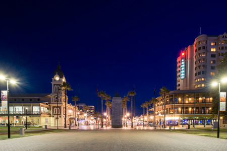 Adelaide, Australia - August 22, 2015: Moseley Square with Pioneer Memorial in the middle at night. Moseley Square is a public square in the City of Holdfast Bay. Long exposure camera settings