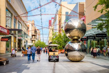 adelaide: Adelaide, Australia - November 11, 2016: Rundle Mall and famous balls looking towards west in Adelaide CBD on a day. Rundle Mall is the premier shopping area of South Australia Editorial