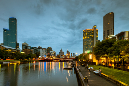southbank: Melbourne, Australia - December 27, 2016: Melbourne city lights and Yarra river at night viewed from Southbank