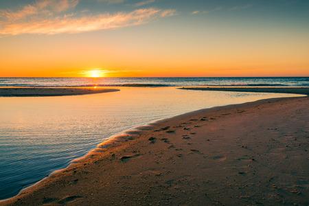 adelaide: Sunset over the sea at Glenelg Beach, South Australia