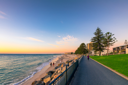 Adelaide, Australia - February 11, 2016: People walking along Esplanade at  Glenelg Beach. Esplanade is a very popular place among locals and tourists Editorial
