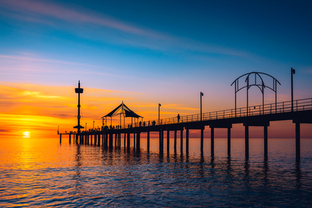 brighton: People walking along Brighton Jetty at sunset. South Australia Stock Photo