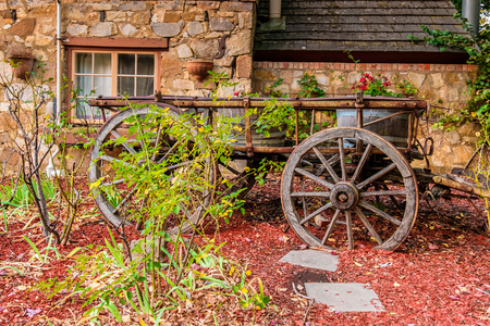 adelaide: Hahndorf, South Australia - April 9, 2017: Old cart installed near Old Mill Hotel in the town of Hahndorf during autumn season