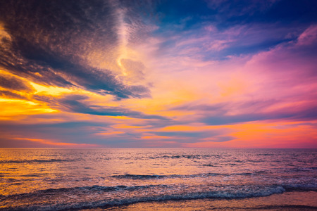 adelaide: Waves and sramatic sunset with colorful clouds over sea at Glenelg Beach, South Australia Stock Photo