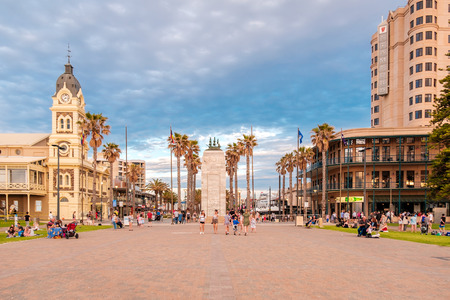 Adelaide, Australia - August 29, 2016: People walking at Moseley Square with Pioneer Memorial in the middle at sunset. Moseley Square is very popular among tourists and locals and located at the end of Jetty Road in Glenelg. Editorial