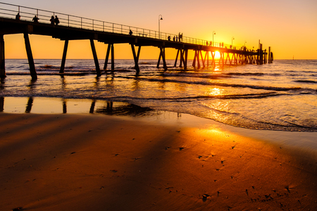adelaide: Glenelg beach jetty with people at sunset, Adelaide, South Australia