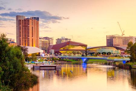 adelaide: Adelaide, Australia - April 05, 2017: Adelaide city skyline at sunset viewed across Torrens river from King William bridge Editorial