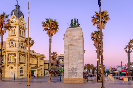 Adelaide, Australia - November 11, 2016: Moseley Square with Pioneer Memorial and tram at sunset. Moseley Square is a historical place and attracts a lot of tourists every day. Editorial