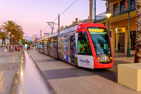 Adelaide, Australia - November 11, 2016: Tram ready to depart from Moseley Square to city at sunset. Moseley Square  attracts a lot of tourists every day.