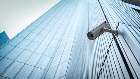 Outdoor CCTV Security camera installed on the building wall in the city Stock Photo