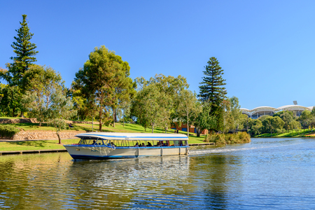 adelaide: Adelaide, Australia - April 14, 2017: Iconic Pop-Eye boat with people on board traveling upstream  Torrens river in Adelaide CBD on a bright day Editorial