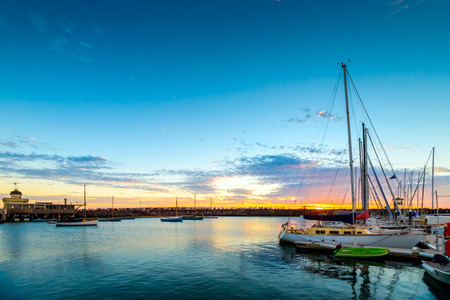 People gathered on St. Kilda Beach breakwaters to watch penguins night show at sunset, Victoria, Australia Stock Photo
