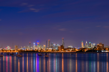 st kilda: Melbourne, Australia - December 27, 2016: Melbourne city illuminated skyscrapers at night viewed from St. Kilda beach Editorial