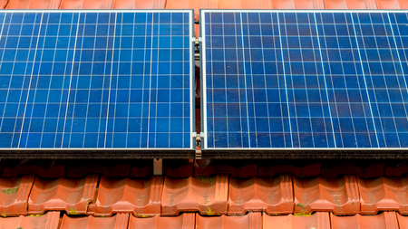 Dirty solar panels on the house roof inMelbourne suburbs, Victoria, Australia