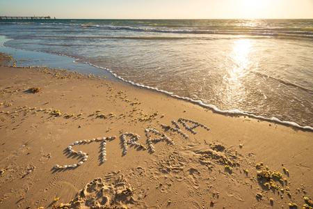 Straya Text Drawn Using Shells On Sand Is An Abbreviation