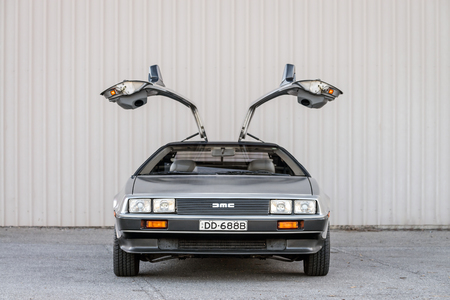 Adelaide, Australia - September 7, 2013: DeLorean DMC-12 car with opened doors parked on street near shed Editorial
