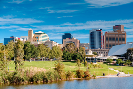 rotunda: Adelaide, Australia - December 2, 2016: Adelaide city skyline on a day viewed through Torrens river in Elder Park on a bright day Editorial