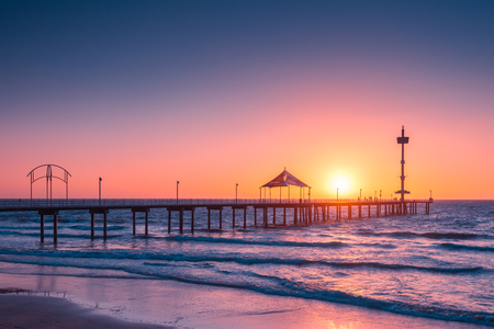 brighton: People walking along Brighton Beach jetty at sunset, South Australia