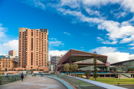 Adelaide, Australia - August 27, 2017: Adelaide InterContinental Hotel and Convention Centre viewed across Torrens river footbridge during winter time
