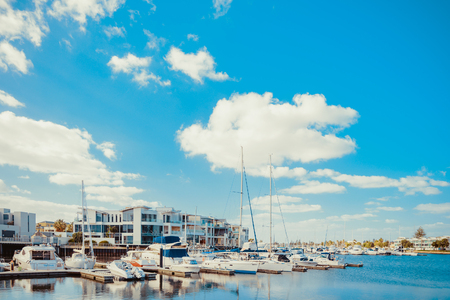 Adelaide, Australia - February 3, 2016: Beautiful view of boats docked in Patawalonga lake at Glenelg on a bright day. Glenelg is one of the reachest suburbs in South Australia